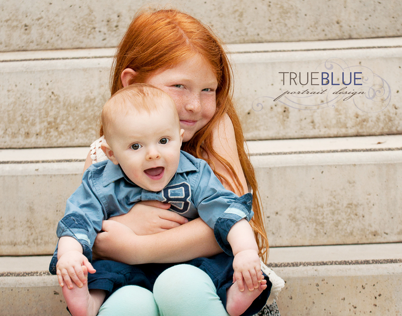 Big sisters love their little brothers. Family portraits by TRUE BLUE Portrait